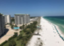 Destin, Florida's white sand beach an gulf front condominiums.