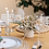 dried flowers bouquet inside white minimalist ceramic put and white candles as dinning table decor