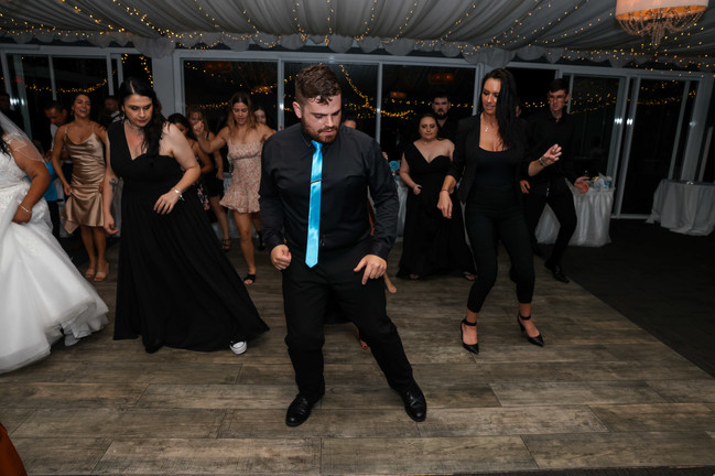 Nathan Cassar: Master of Ceremonies leading the line dances in the middle of the dance floor with guests