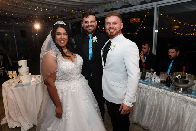 Nathan Cassar: Master of Ceremonies poses with happy newlyweds, Aaron and Jade