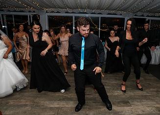 Nathan Cassar - Master of Ceremonies on the dancefloor with guests dancing in front