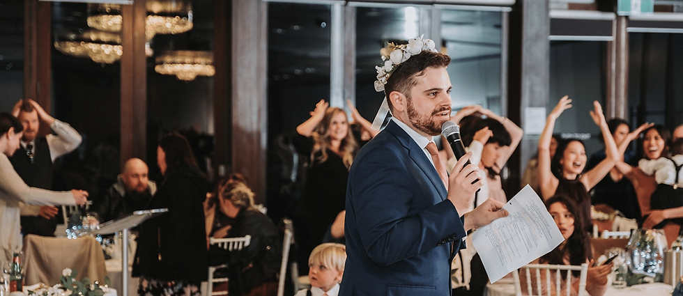 Nathan Cassar, Master of Ceremonies entertaining excited guests at a wedding in a blue suit