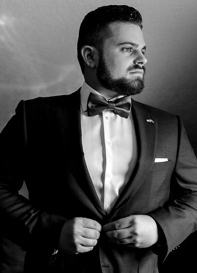 Black and white photo of Nathan Cassar in a suit