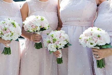 Women holding wedding bouquets from Estrella's Flower Shop in Dallas, TX