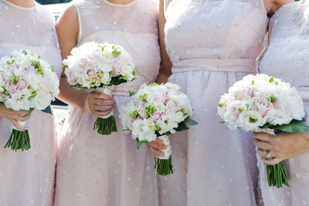 Women holding wedding bouquets from Estrella's Flower Shop in Dallas, TX