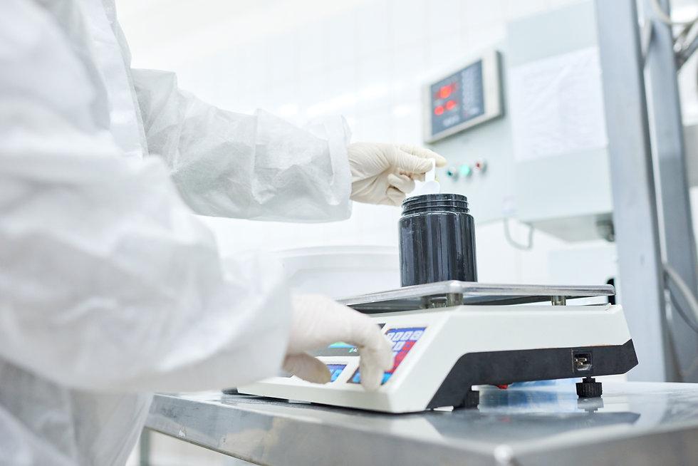 Scientist picking up sample