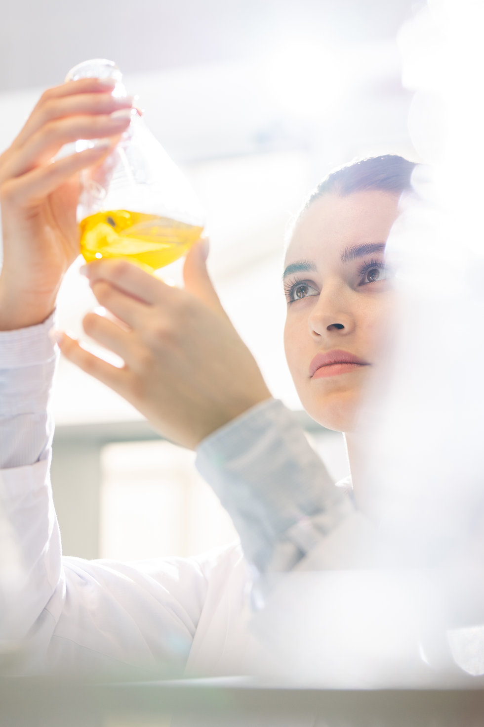 Female APRC scientist inspecting sample