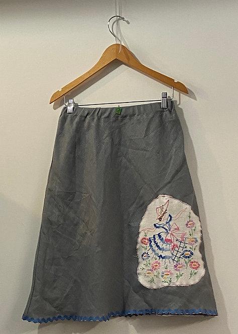 grey lady in flower garden skirt