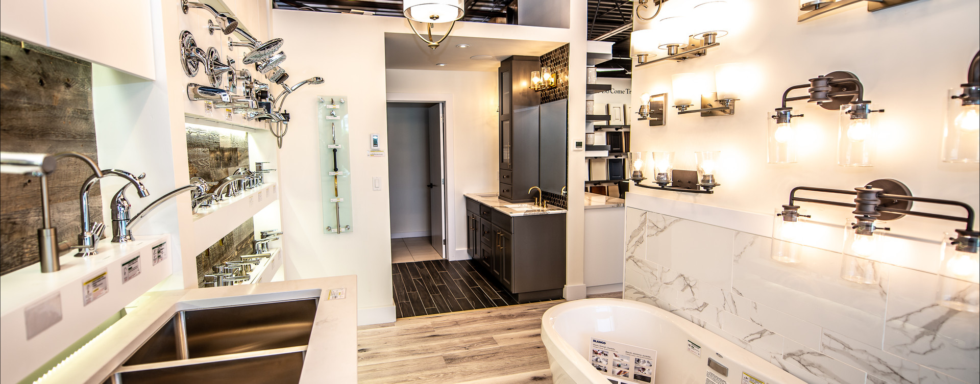 Modern bathroom design with bathroom finishes displayed on wall.