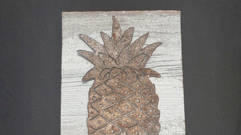 Rusty pineapple on vintage board
