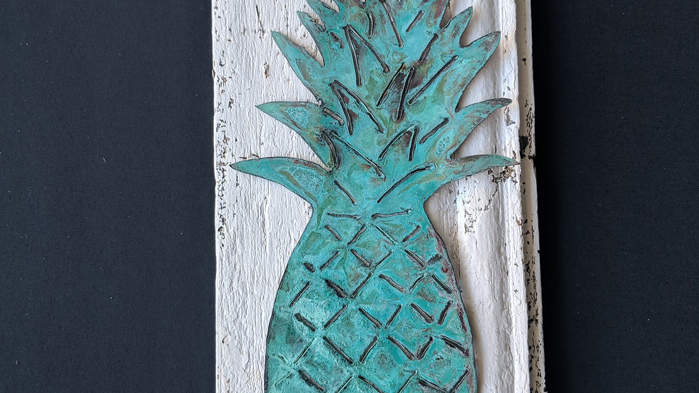 Copper pineapple on vintage shiplap.