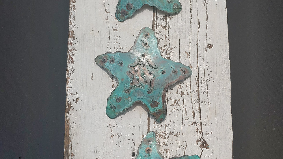 3 copper starfish on vintage barnwood