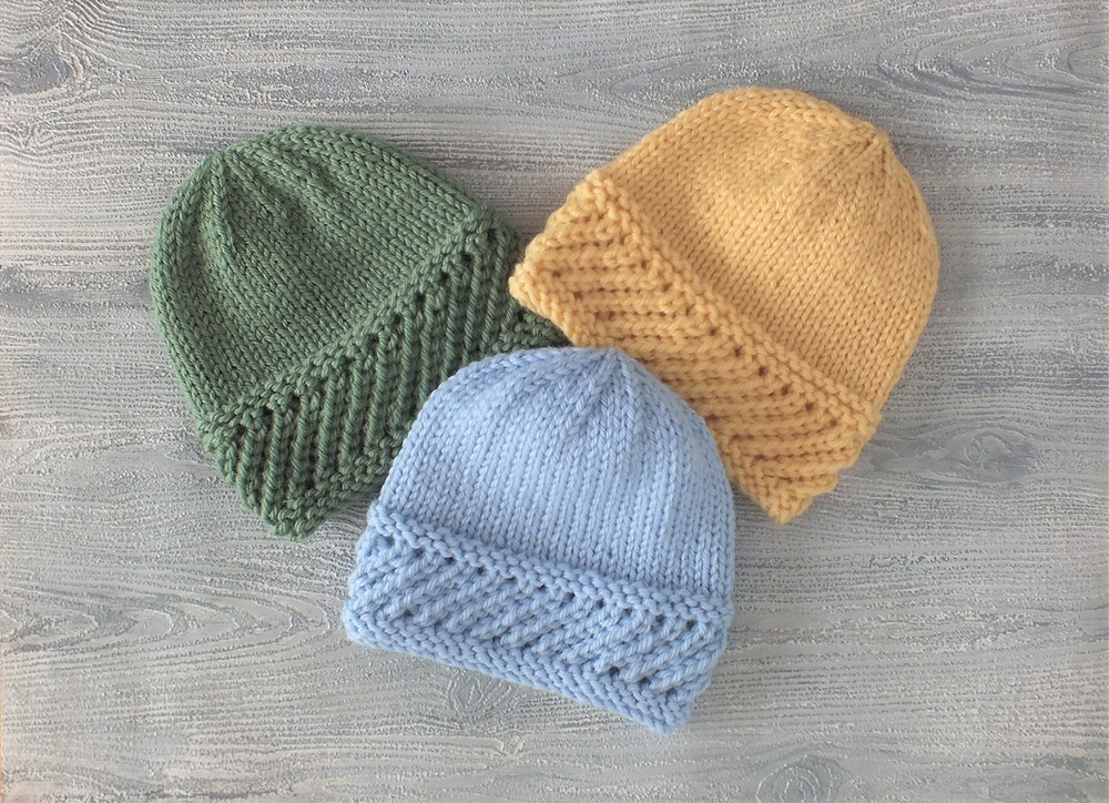 Three colours of baby beanies