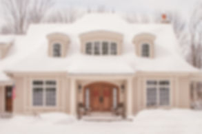 white snow covered custom home