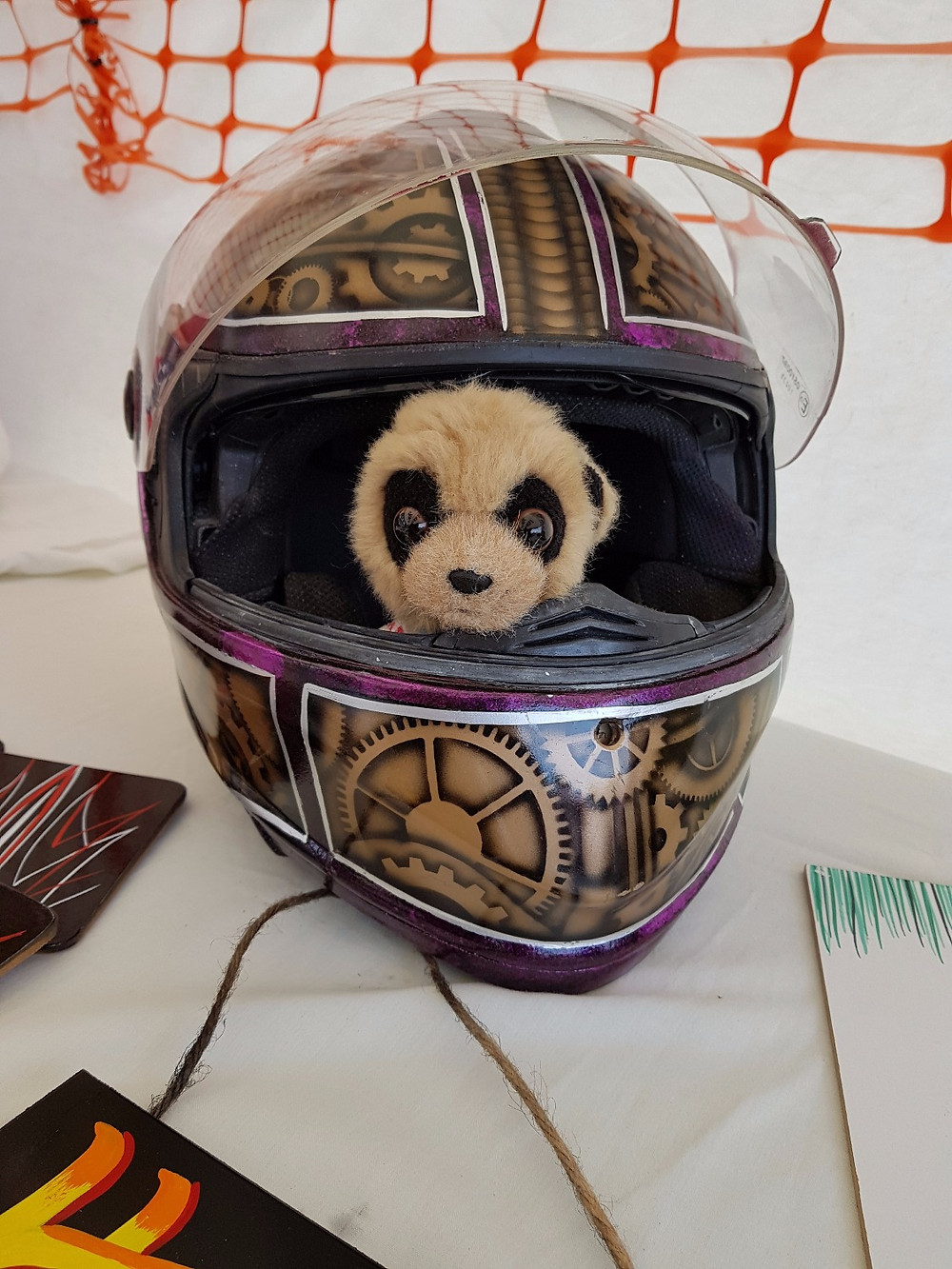 Oleg tries out a crash helmet.