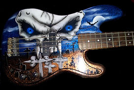 Airbrush skull and graveyard scene on bass guitar
