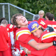 Nolan was not afraid to hug people much bigger than him (and sweatier)