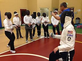 A FRFC Fencing Coach explains action.