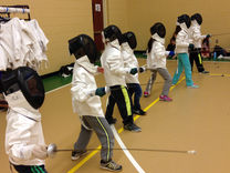 Fencers pu on gear for first time