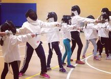 Students learn the fencing attack