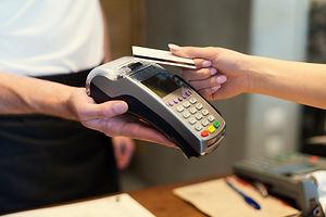 close-up-customer-paying-by-credit-card.