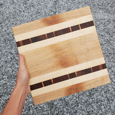 MAPLE CUTTING BOARD WITH DOUBLE CHAOS STRIP - $65