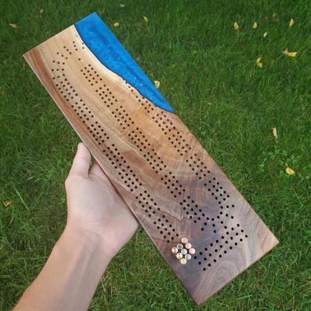 WALNUT CRIBBAGE BOARD W/ BLUE EPOXY - $120