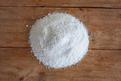 detergent washing powder on wood backgro