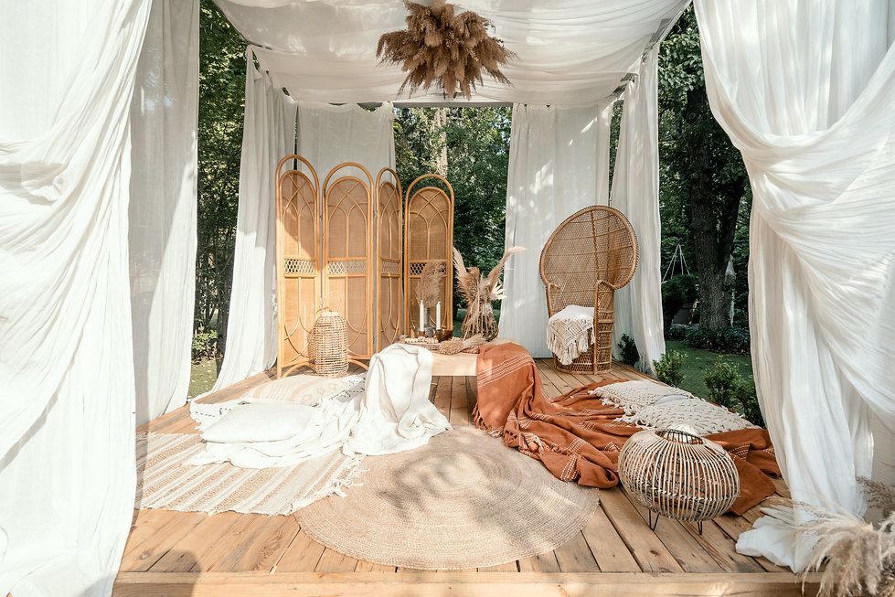 Garden arbour with rustic beige decoration, outdoor design. Wicker furniture outside in bo