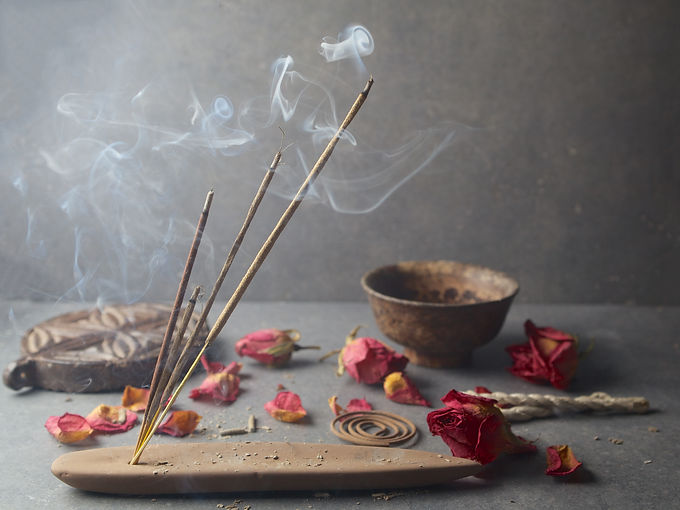 incense sticks with rose flowers leaves.