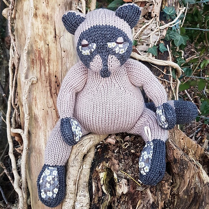 hand knitted tricksy racoon