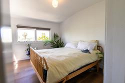 Second suite: Bedroom with walls of windows