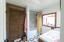 Master bath with geometric tile
