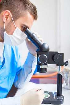 portrait-of-chemist-working-with-microsc