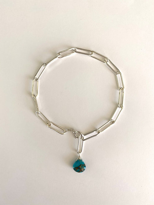 Sterling silver oval link bracelet with copper infused turquoise drop