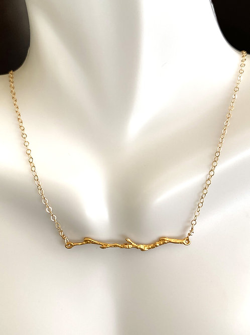 Delicate gold branch with  gold  chain