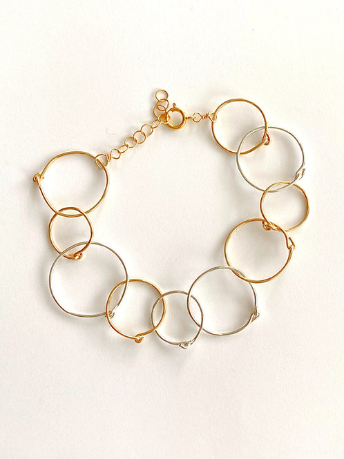 Sterling and gold hand forged textured circles bracelet