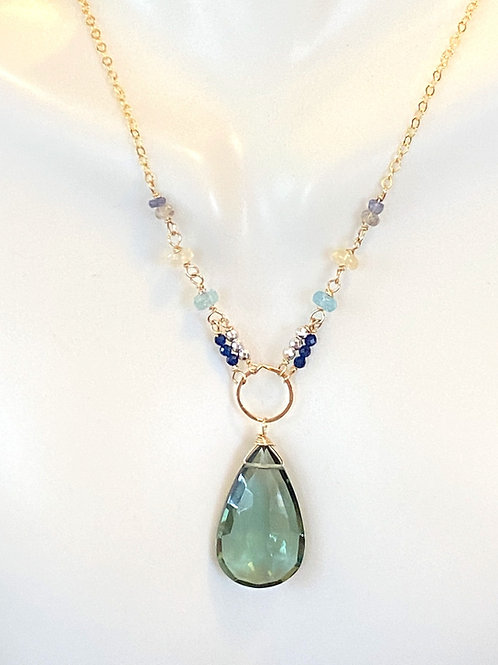 Green amethyst with opal, apatite, iolite, silver pyrite, and blue qtz on gold