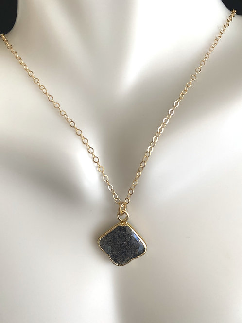 Rutilated quartz pendant with  gold