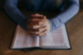 hands-folded-on-open-bible-208x138.jpg