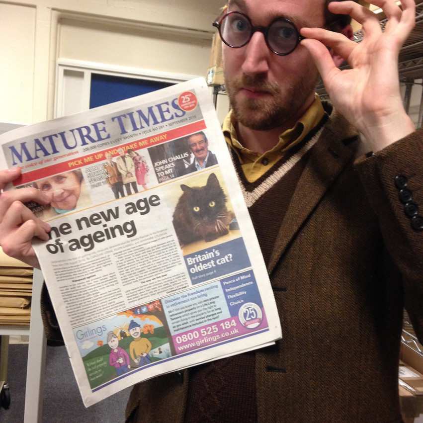 Mike checking the local news in Workington library
