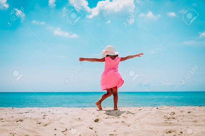 happy-little-girl-dance-play-on-tropical