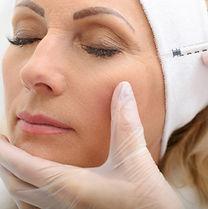Senior lady having botox injecting proce