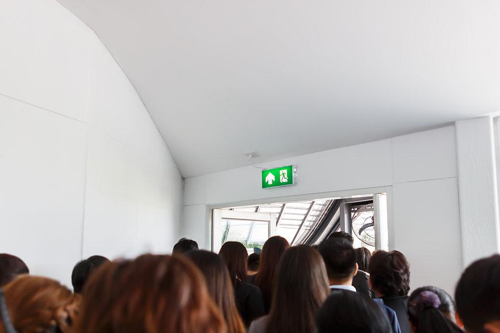 People escape to fire exit door.jpg