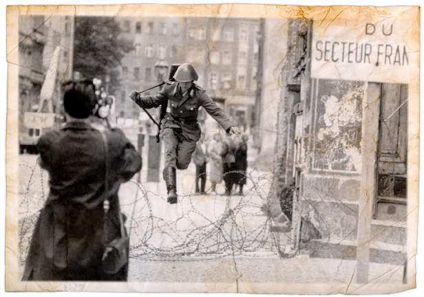 Conrad Schumann and his famous jump into the French sector from East Berlin in 1961? Getting permission to use this image has been difficult thus far, so sadly I had to remove my digitally altered version (above) from my book.