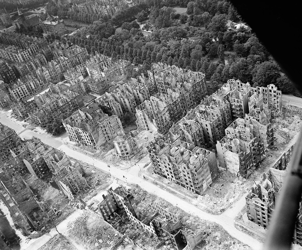Royal Air Force Bomber Command, 1942-1945. Oblique aerial view of ruined residential and commercial buildings south of the Eilbektal Park (seen at upper right) in the Eilbek district of Hamburg, Germany. These were among the 16,000 multi-storeyed apartment buildings destroyed by the firestorm which developed during the raid by Bomber Command on the night of 27/28 July 1943 (Operation GOMORRAH). The road running diagonally from upper left to lower right is Eilbeker Weg, crossed by Rückertstraße.