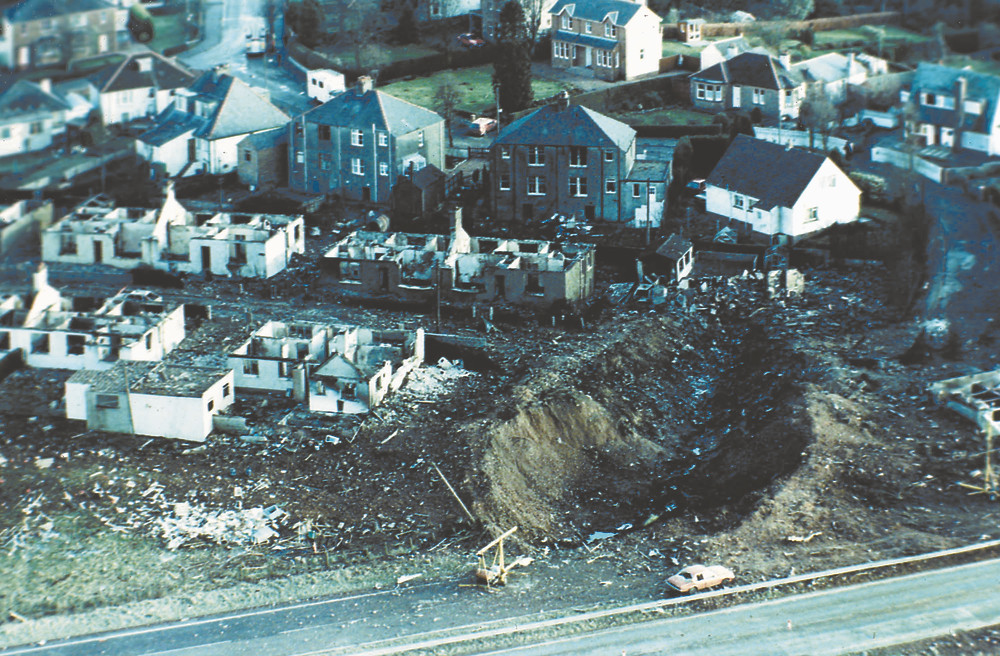 Pan Am Flight 103 was flying at an altitude of 31,000 feet over Lockerbie, Scotland, when a terrorist bomb exploded on board. The plane's wings, along with tanks carrying 100 tons of jet fuel, crashed into the Sherwood Crescent neighborhood, creating an inferno and a crater more than 150 feet deep. Eleven residents were killed instantly. (AP photo)