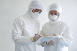 doctor and nurse are wearing PPE and loo