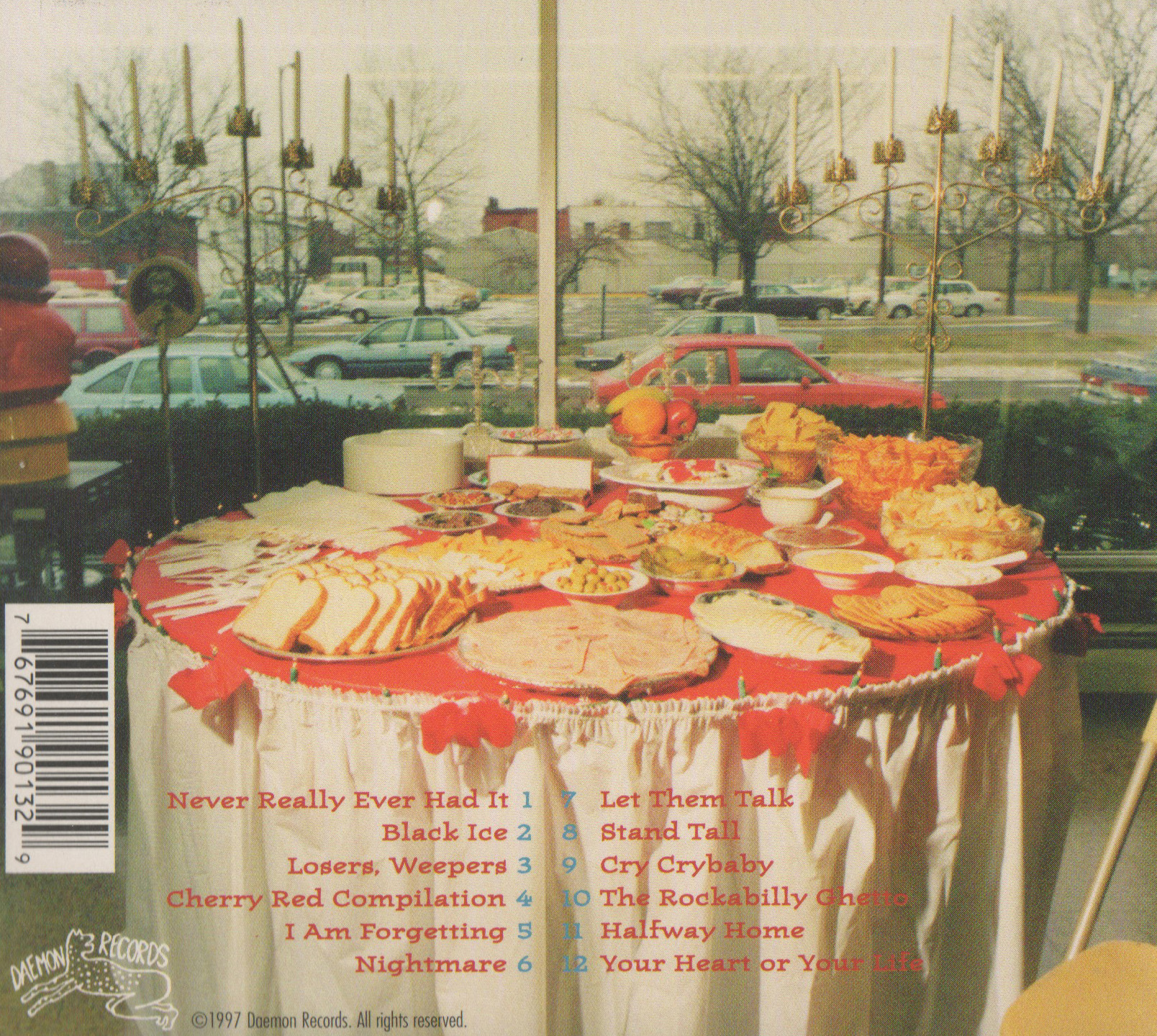 """Back cover of The Rock*A*Teens - Cry (Daemon Records, 1997)  Photo: """"Don Cantrell's Big Christmas Party"""""""
