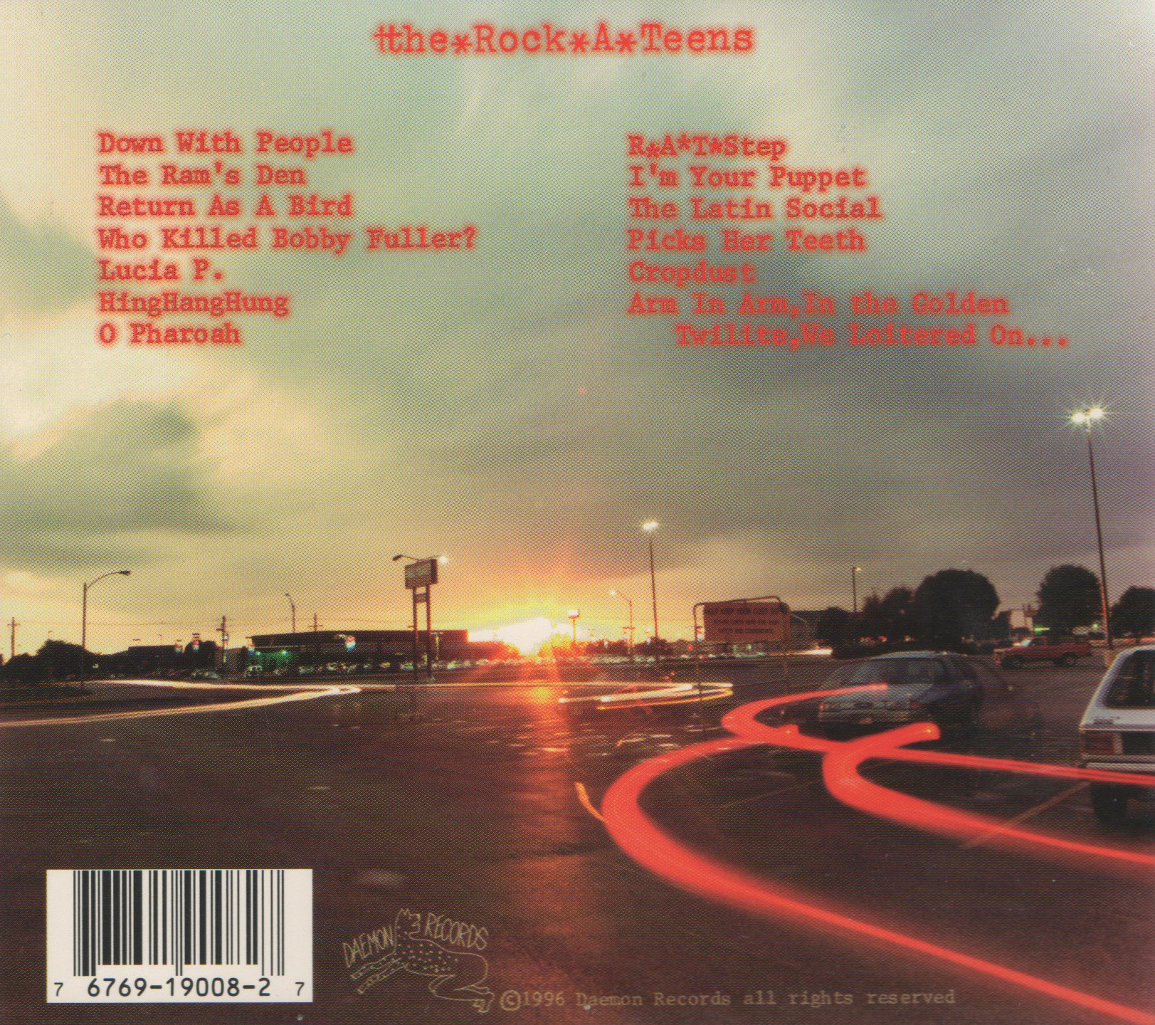 """Back cover of The Rock*A*Teens self-titled debut (Daemon Records, 1996)  Photo: """"Sunset at the Wal-mart Parking Lot"""""""
